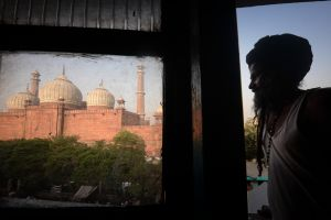 A Sufi pilgrim in his room near the Jama Masjid in Delhi.
