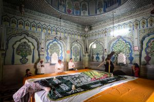 People pray in a Sufi shrine at the tomb of a saint.