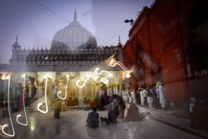 Evening prayers at the shrine of the Sufi saint Nizamuddin Auliya in Delhi.