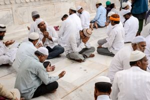 Pilgrims in contemplation and prayer in Ajmer.