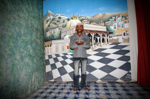 A pilgrim posing at a studio in Ajmer for a commemorative photo of his visit to the shrine of Moin-ud-din Chishti.