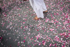 A street in Ajmer strewn with rose petals.