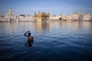 A man taking a ritual bath in the sacred pool of the Golden Temple in Amritsar, the Sikhs' holiest pilgrimage place.