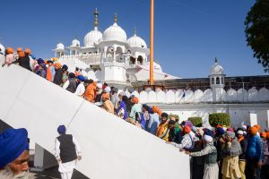 Sikhs queue up to enter a Gurudwara during a festival.