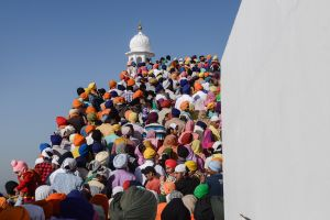 "Pilgrims entering a Gurudwara, as Sikh temple are known. Literally translated the word Gurudwara means ""Gateway to the Guru."""