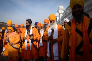 "Sikh Sants, or holy men and women, at the Golden Temple. The Punjabi word ""Sant"" is cognate with the word ""Sat,"" which means ""Truth."" So, the Sikh Sants are not saints, in the Western sense, but rather the tellers of Truth, people with direct experience of Ultimate Reality."