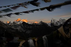 Prayer flags frame Everest, Lhotse and Makalu, three 8,000 meter peaks on the border of Tibet and Nepal.