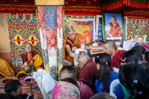 A Buddhist lama giving blessings to pilgrims.