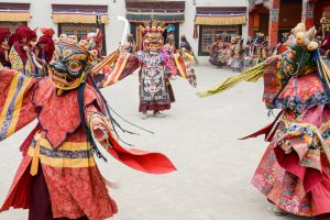 Monks dressed as wrathful deities during a performance of the sacred Cham dance.