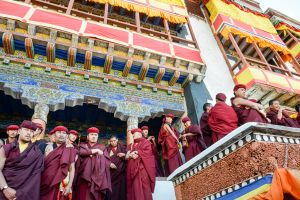 Buddhist monks watch during a Cham ritual.
