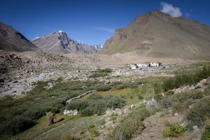 A woman heads home to a village consisting only of three houses in a remote valley of Zanskar.