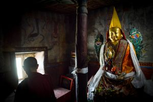 A monk inside a chapel.