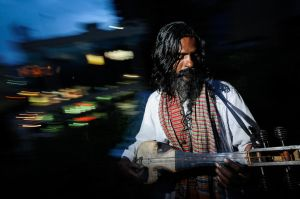 A Baul Fakir sings on a rooftop above the lights and noise of the Bangladesh capital Dhaka.