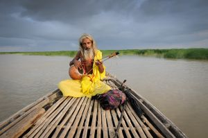 A Baul Fakir traveling down the Padma River in Bangladesh.