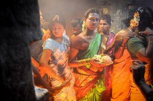 Hijras in a temple present offerings to their husband, the Hindu god Aravan.