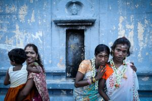 Hijras in front of a temple to their husband, the god Aravan.