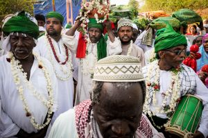 Indians of African descent, known as Sidis, march in procession to the shrine of their ancestor, the African Sufi saint Bava Gor.