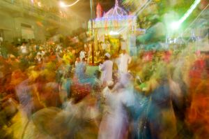 People dance Goma in a circle in front of a Sidi saint's shrine in Bhuj.
