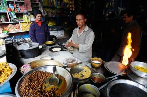 Dozens of ramshakle shops, serving tea and simple meals, line the trail to Kedarnath.  An odd-looking chef with no eyebrows prepares chapatis -- Indian bread.