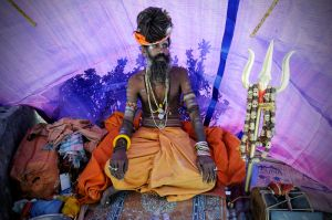 Some Sadhus undertake severe penances -- such as sleeping while standing or alway keeping one arm raised high in the air.  This sadhu is a Muni Baba -- one who has taken a vow of silence and has not spoken in years.