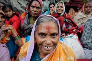 A tribal woman with a tattooed face elated at the conclusion of her pilgrimage.  After finishing the trek to Kedarnath many pilgrims visit other Hindu holy sites in the Himalaya before returning home.