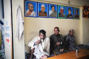Beneath a pantheon of Indian heroes, pilgrims in a Gaurikund tea shop fortify themselves before the start of their trek.